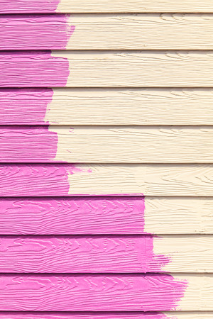 paintroller: Pink color painting wall