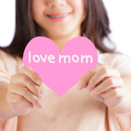 Woman holding pink heart with love mom Stock Photo