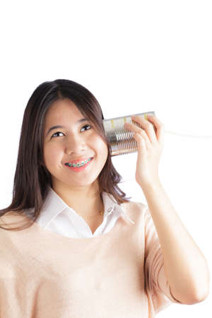 Young woman with tin can telephone photo