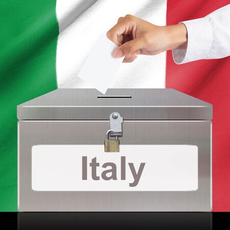 ballot box: Hand with ballot and metal box with Italy flag, elections and democracy concept
