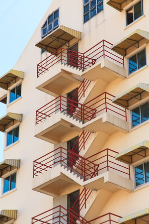 Fire escape ladder on the side of a building photo