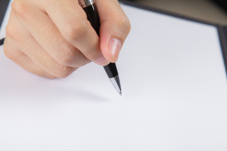 Businessman signing a document photo