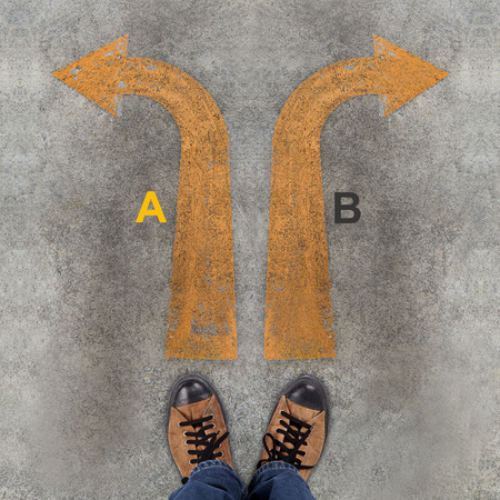 Pair of shoes and two arrows with A, B photo