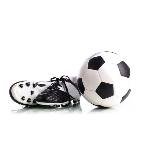 soccer shoes: Soccer ball and soccer shoes on white background