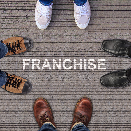 four pairs of shoes with franchise photo