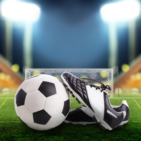 soccer shoes: Soccer ball and soccer shoes on the field