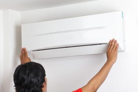 man repair air conditioner  photo