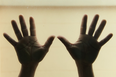 Hands on glass photo