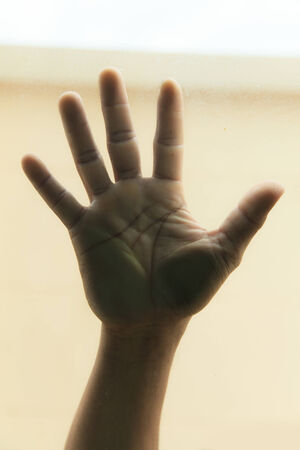 Hand on glass photo