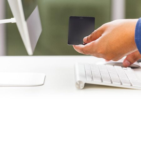 Businessman typing and making online payment with credit card photo