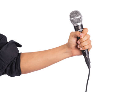 Male hand holding microphone on white background photo