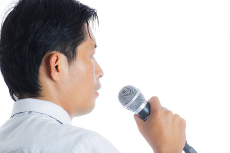 Portrait of a man holding a microphone conducting a business interview or press conference photo