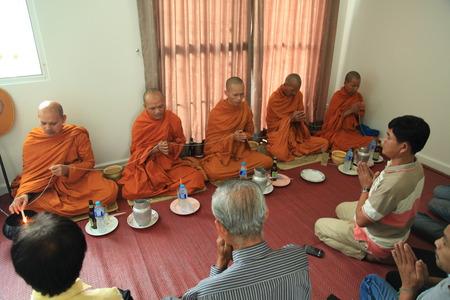BANGKOK, THAILAND - OCTOBER 12: Buddhist monk praying, Thailand on October 12, 2014, buddhist monks praying for to a housewarming in Bangkok, Thailand Editorial