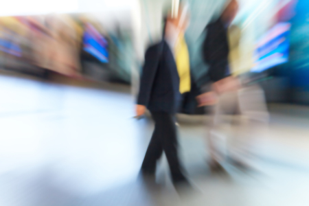Business people walking in the city in motion blur photo