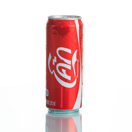 BANGKOK, THAILAND - December 25, 2014: Photo of long can of Coca-Cola on white background. Coca-cola is the Worlds most selling carbonated soft drink.