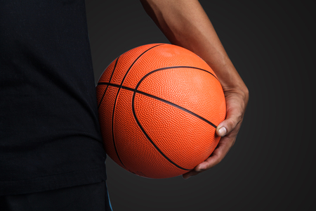 Basketball ball in hands