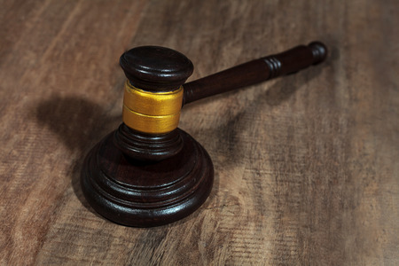 defendant: judge gavel on wooden background