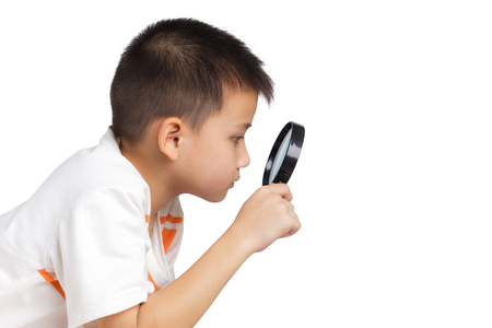 magnifier glass: Boy holding a magnifying glass