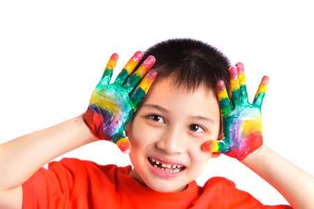 kids painted hands: Little boy enjoying his painting with hands painted in colorful paint on white background