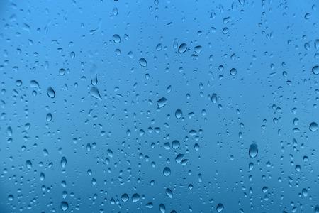 blue bubbles: Rain on glass, background texture