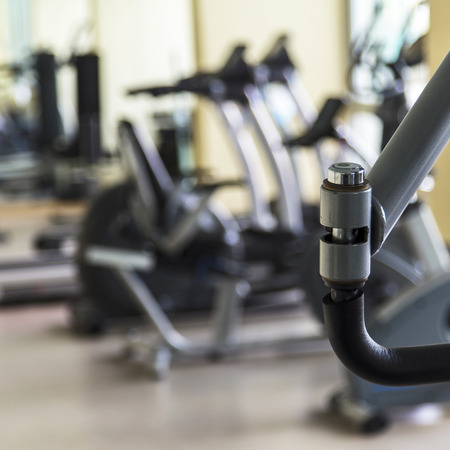 healthcare facilities: Empty fitness center with different training equipment Stock Photo