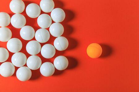 think different: Orange ball and white balls, Think different concept or Leadership concept