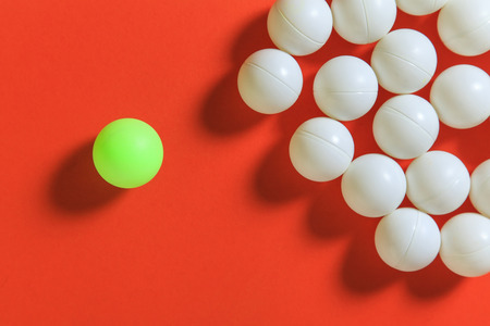 think different: Green ball and white balls, Think different concept or Leadership concept