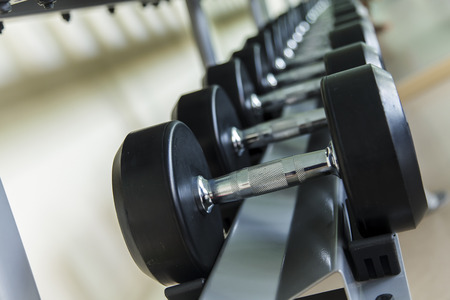 healthcare facilities: Dumbbells lined up in a fitness studio, sport gym, Shot focus Stock Photo