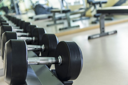private club: Empty fitness center with different training equipment Stock Photo