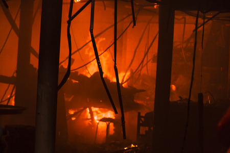arson: House fire with heavy flame and smoke