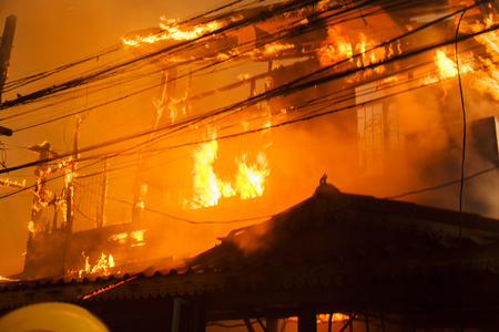 House fire with heavy flame and smoke