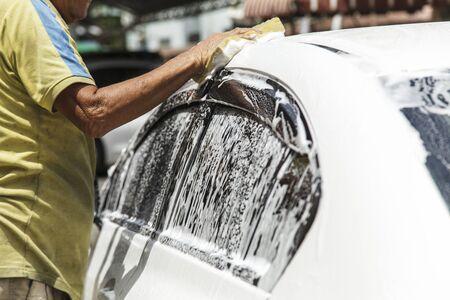 wash: Washing a car at car wash service
