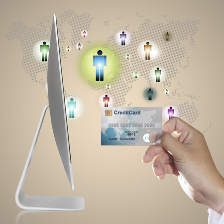 online purchase: Hand holding credit card for online shopping concept