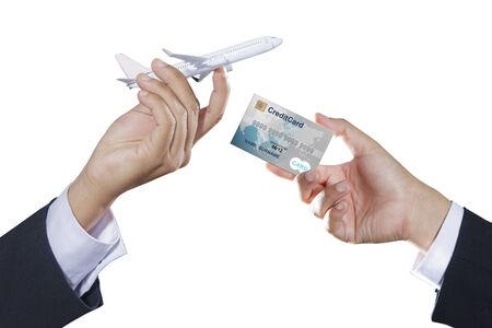 cargo plane: Airplane and credit card on businessman hand, online booking concept Stock Photo
