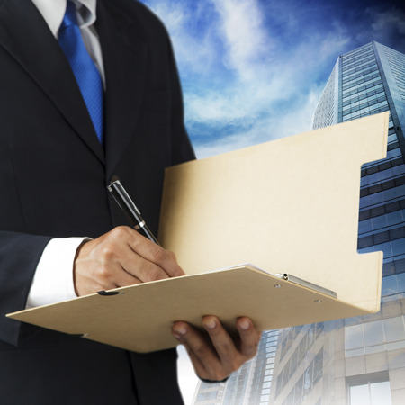 undersign: businessman and city working with documents sign up contract Stock Photo