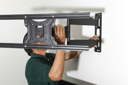 mount: Installing mount TV on the wall at home Stock Photo