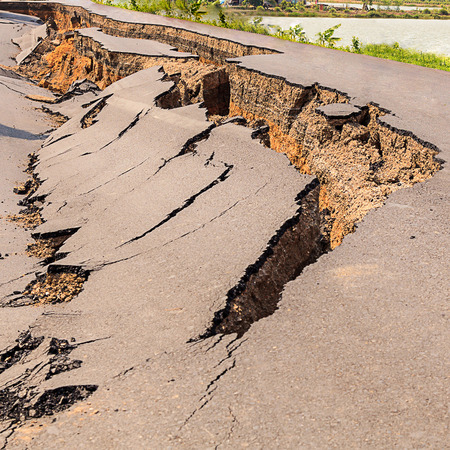 Cracked of asphalt road after the earthquake Stock Photo