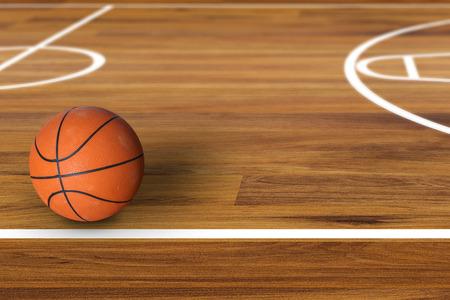 Bola del baloncesto sobre cancha de baloncesto de madera Foto de archivo - 45060956