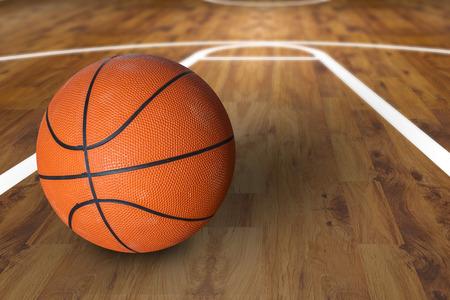 baloncesto: Bola del baloncesto sobre cancha de baloncesto de madera