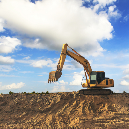 construction vehicle: Excavator with blue sky