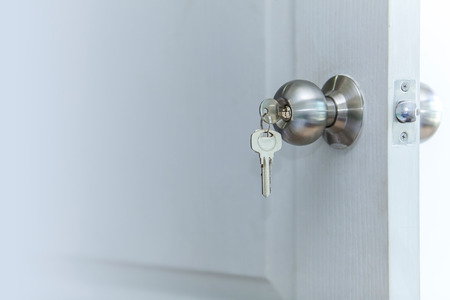open house: Open door with keys, key in keyhole