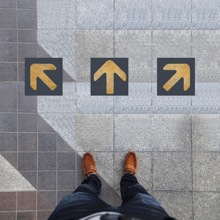 confused guidance: Pair of shoes standing with three yellow arrow