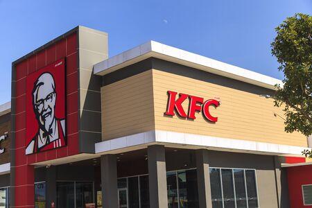 specializes: AYUTTHAYA, THAILAND- NOVEMBER 19, 2015: Exterior view of KFC restaurant in Ayutthaya, THAILAND. KFC is a fast food restaurant chain that specializes in fried chicken