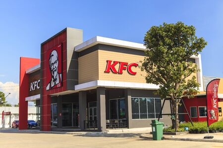 specializes: AYUTTHAYA, THAILAND- NOVEMBER 19, 2015: Exterior view of KFC restaurant in Ayutthaya, THAILAND. KFC is a fast food restaurant chain that specializes in fried chicken