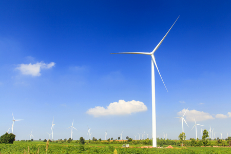 Wind turbine renewable energy source summer landscape with blue sky