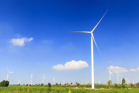 Wind turbine renewable energy source summer landscape with blue sky