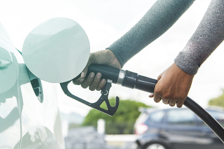 refilling: Hand refilling the car with fuel