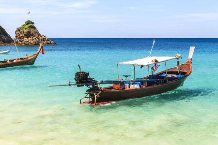 phuket province: Traditional thai longtail boat at famous sunny Long Beach, Thailand, phuket province, Andaman sea