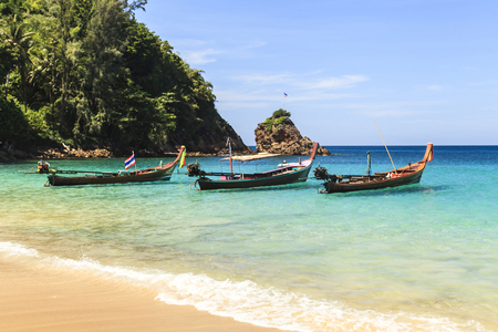 longtail: Traditional thai longtail boat at famous sunny Long Beach, Thailand, phuket province, Andaman sea