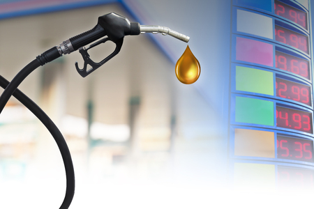 natural gas prices: Gasoline Fuel Nozzle giving a oil drop Stock Photo